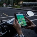playing pokemon go on scooter